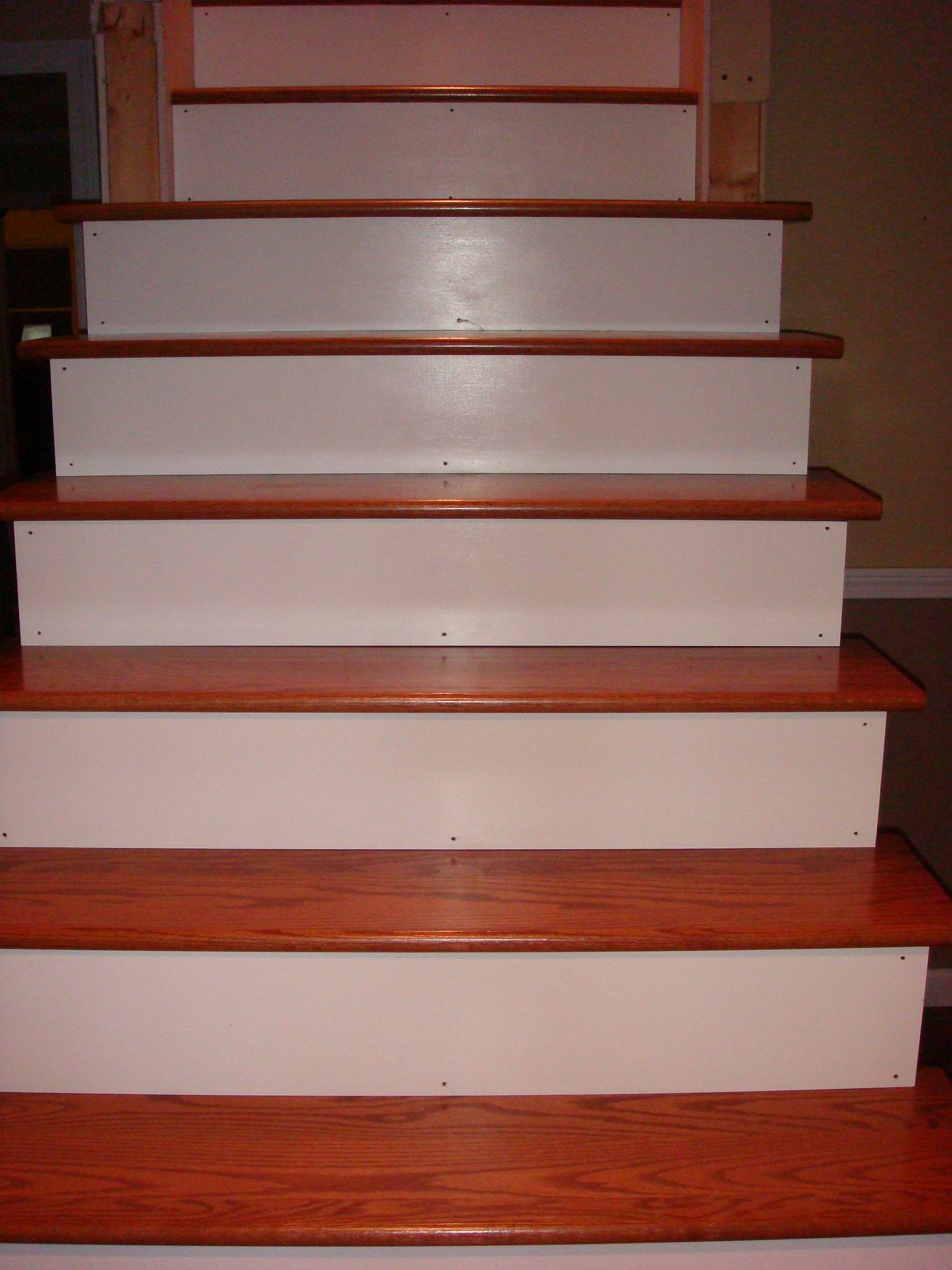 Remodelaholic from carpet to wooden stair treads guest for Painted stair treads